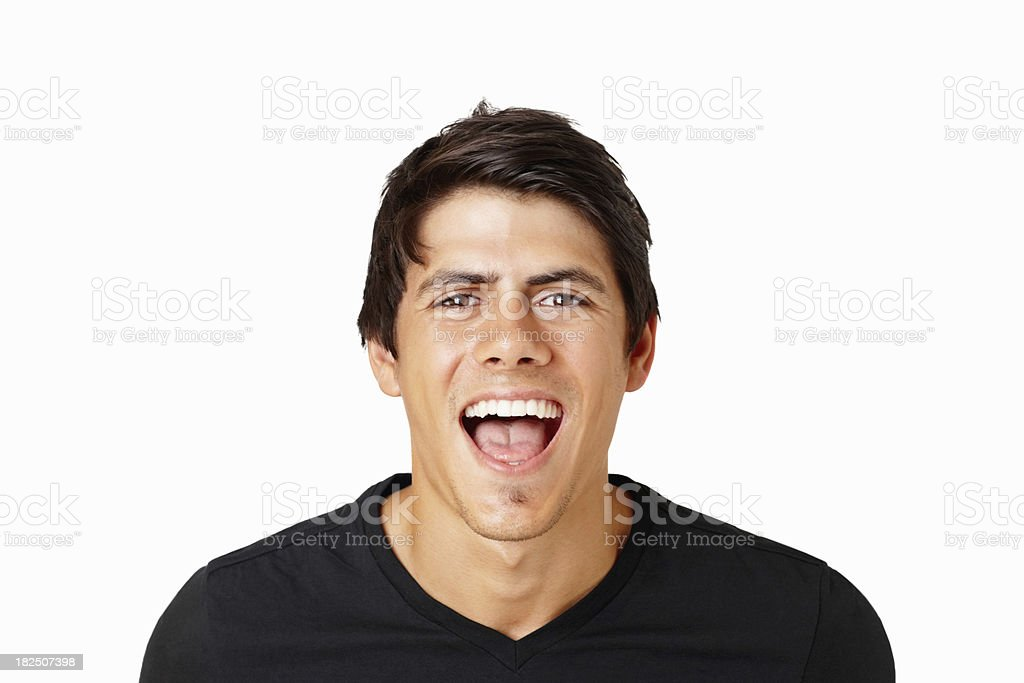 Smart young man shouting with joy against white stock photo