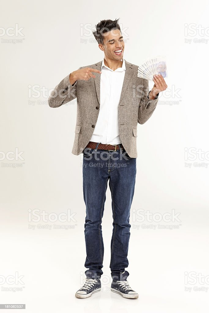 Smart young man showing lots of money stock photo