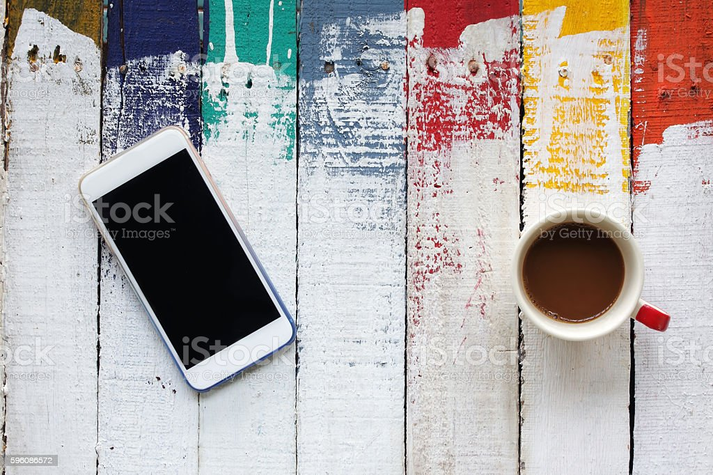 smartphone and coffee cup on panels royalty-free stock photo