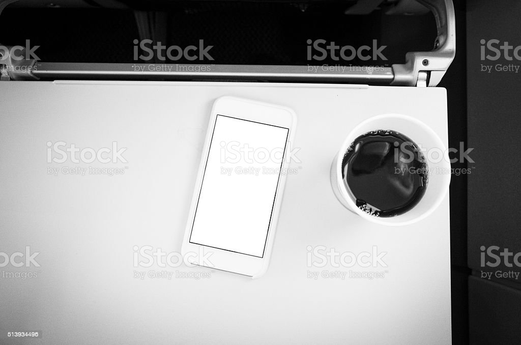 Smartphone and Coffee in Passenger Jet Airplane royalty-free stock photo