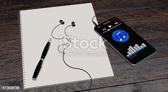 smartphone and earphones on wooden table with paper drawing pad