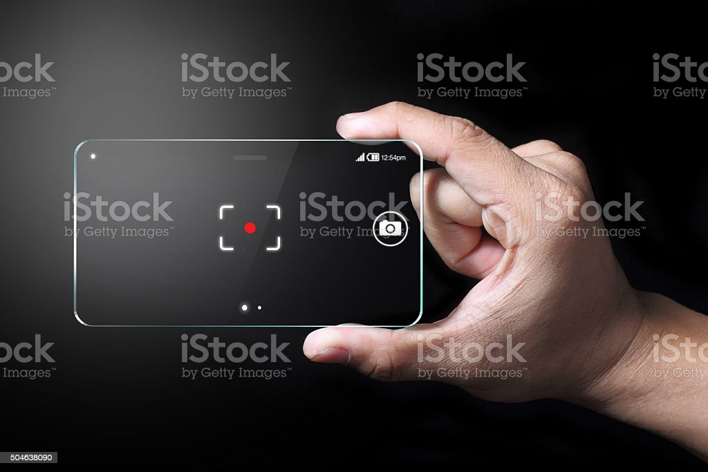 Smartphone and focus point with hand on dark background. stock photo