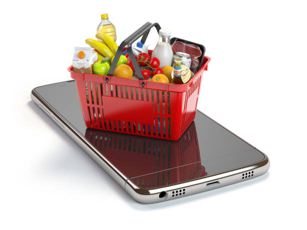 Smartphone and shopping basket with  food and drink. Online grocery supermarket concept. stock photo