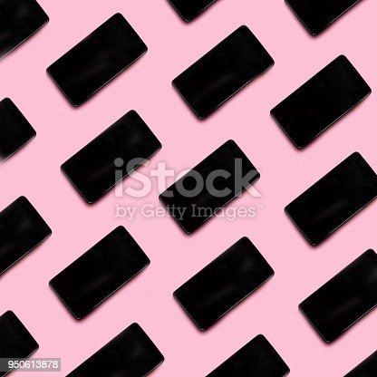 istock smartphone black pattern on a pink pastel background 950613878