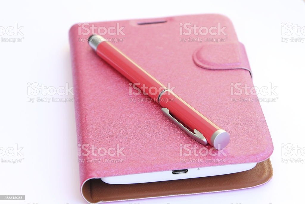 smartphone case and red pen royalty-free stock photo