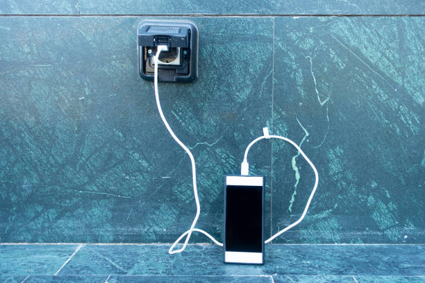 Smartphone Charging Smartphone Charging battery charger stock pictures, royalty-free photos & images