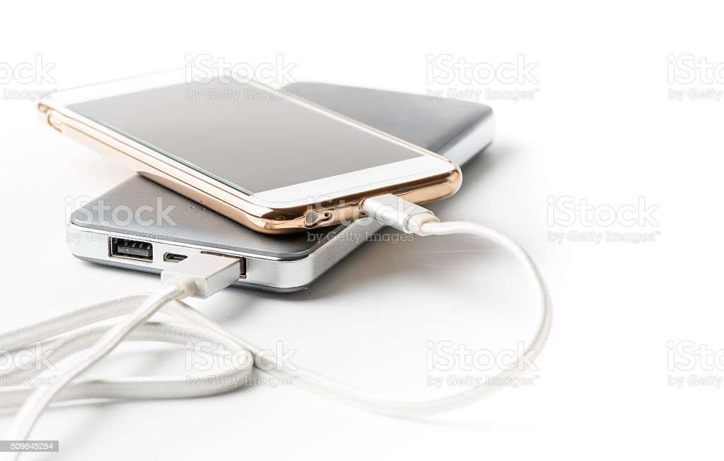 Smartphone charging with power bank stock photo