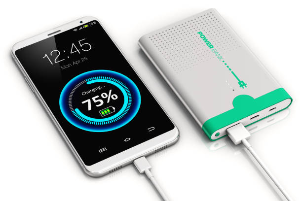 Smartphone charging with power bank 3D render illustration of smartphone or mobile phone charging by a portable power bank rechargeable battery pack isolated on white background battery charger stock pictures, royalty-free photos & images