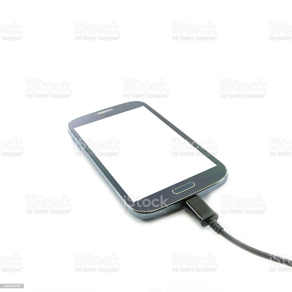 Smartphone con cargador de conexión foto de stock libre de derechos