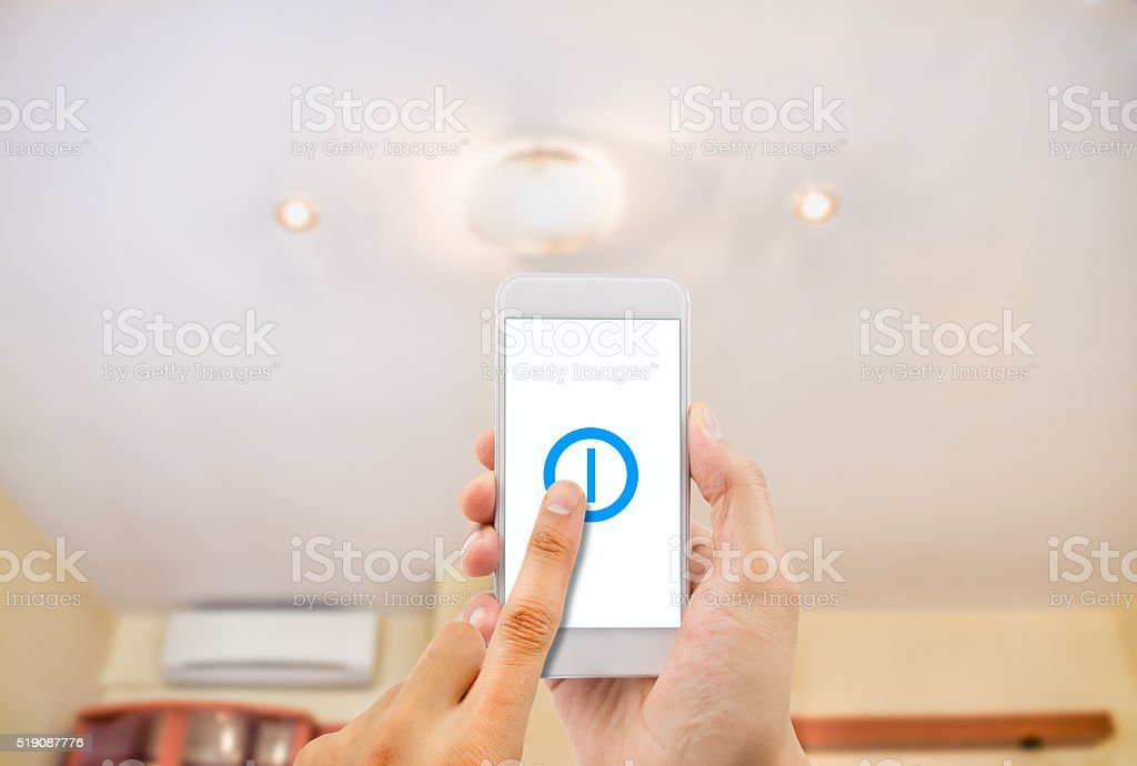 smartphone controlling an light stock photo