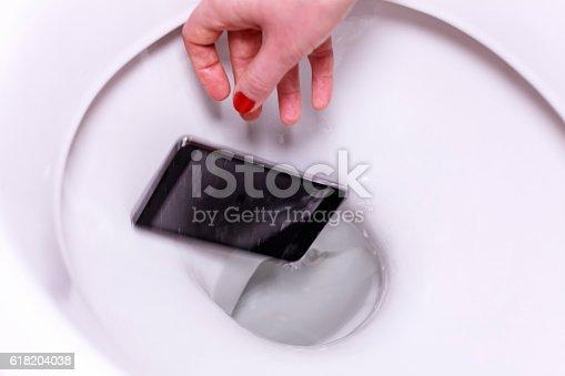 istock Smartphone Fallen into the Toilet Bowl 618204038