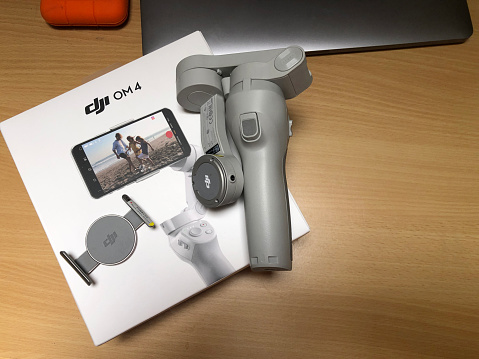 DJI OM4 Smartphone Gimbal and Packaging Box directly above office workspace