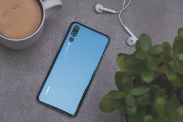 Smartphone Huawei P20 Pro in blue colour. Warsaw, Poland - October 07,2018: Smartphone Huawei P20 Pro in blue colour. huawei stock pictures, royalty-free photos & images