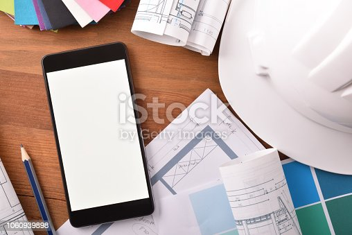 534196421istockphoto Smartphone in an architect's office top view close up 1060939898