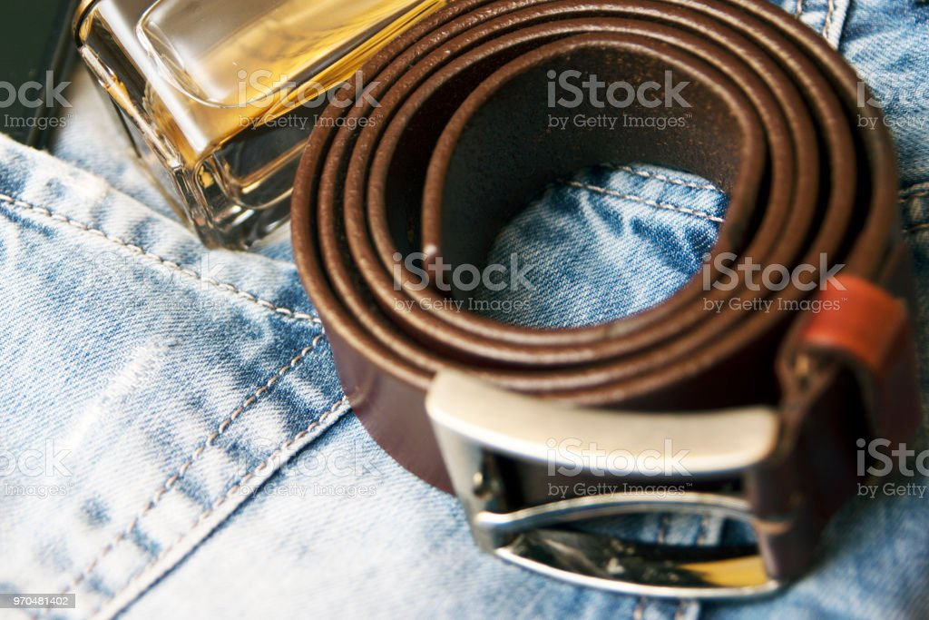 Smartphone in back pocket of jeans with perfume stock photo