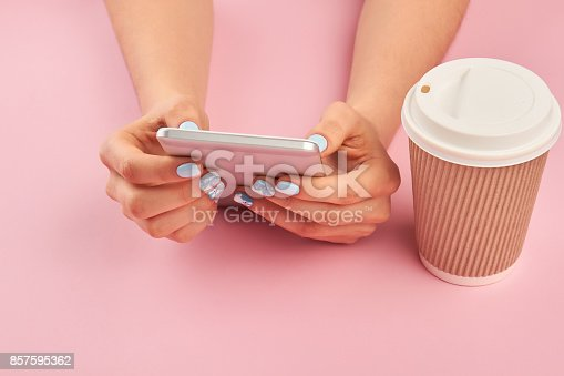 istock Smartphone in female manicured hands. 857595362