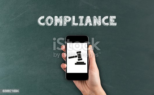 istock Smartphone in hand and Compliance Concept on screen 638821694