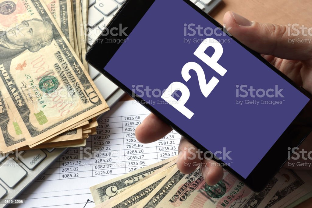 Smartphone in hand with P2P. Peer to peer lending concept. stock photo