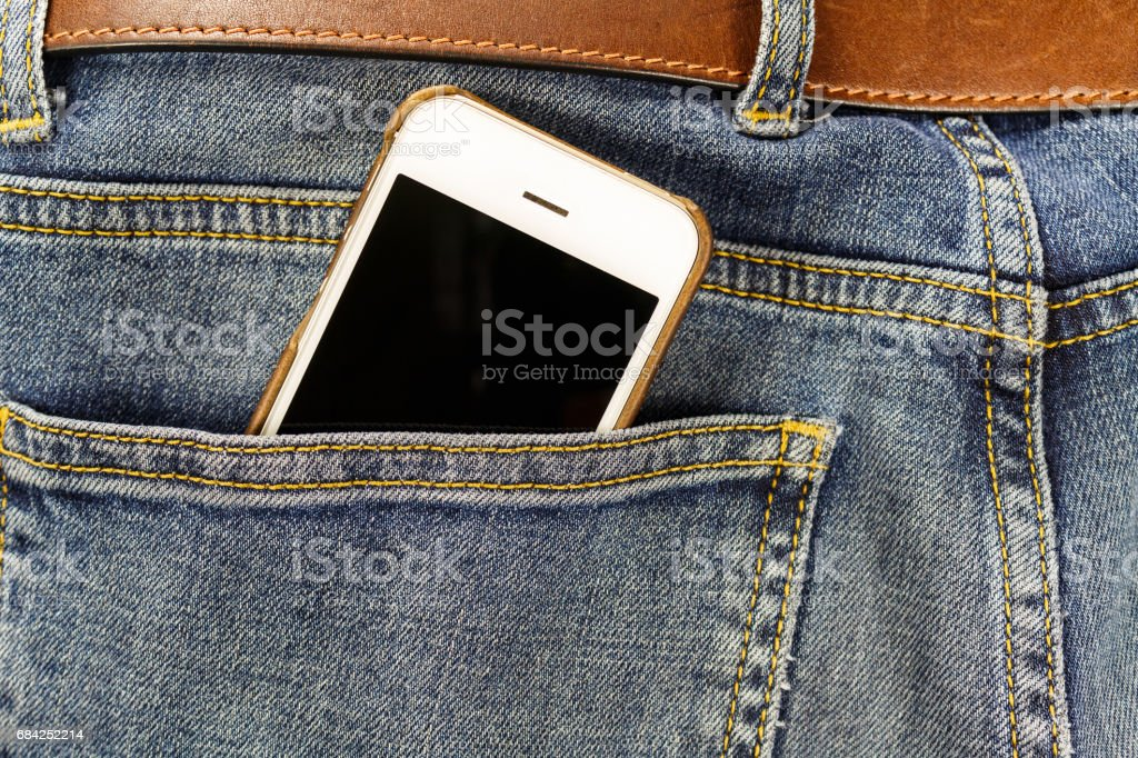Smartphone in the back pocket of the jeans closeup royalty-free stock photo