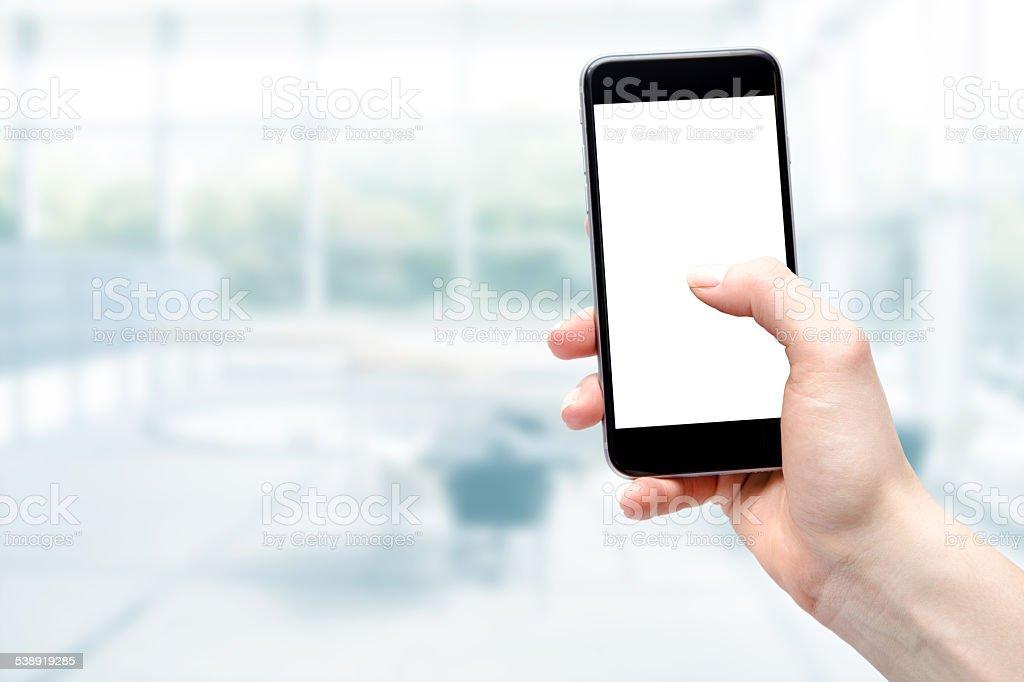 smartphone in the hands of women stock photo
