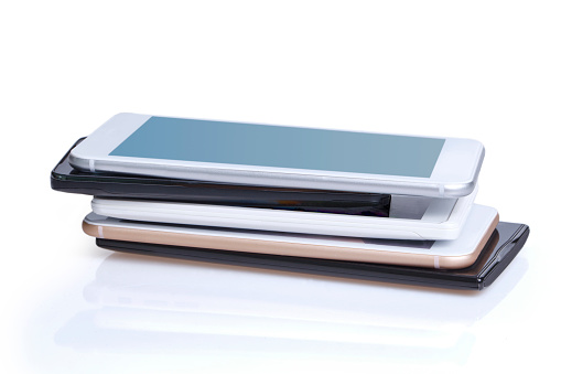 smartphoneis piled