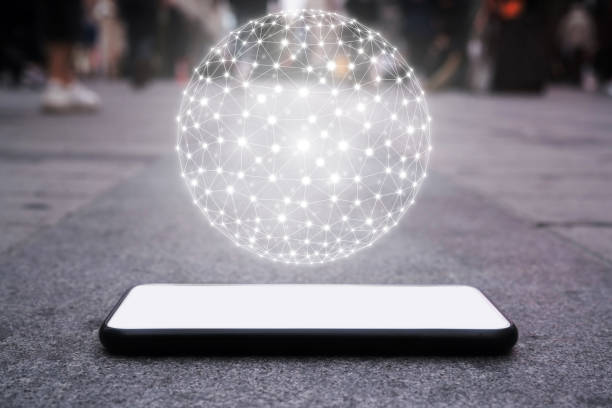 Smartphone lie on the ground,polygon mesh sphere, Future concept stock photo