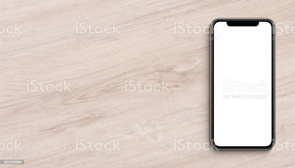 Smartphone mockup flat lay top view lying on wooden office desk banner with copy space