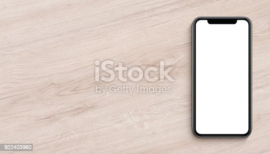 istock Smartphone mockup flat lay top view lying on wooden office desk banner with copy space 922403960