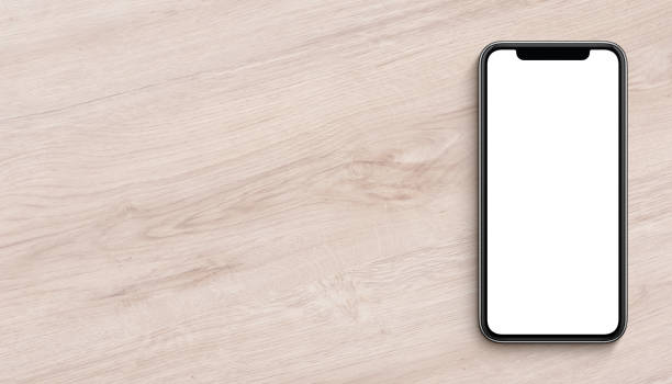 smartphone mockup flat lay top view lying on wooden office desk banner with copy space - phone screen stock photos and pictures