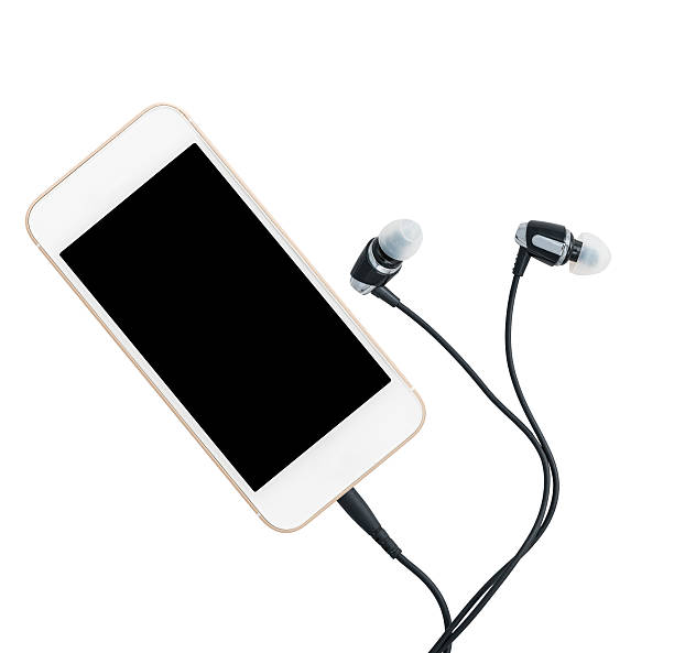 smartphone music player and earbuds - écouteurs intra auriculaires photos et images de collection