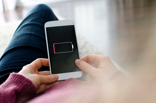 Smartphone needs charging with battery low symbol