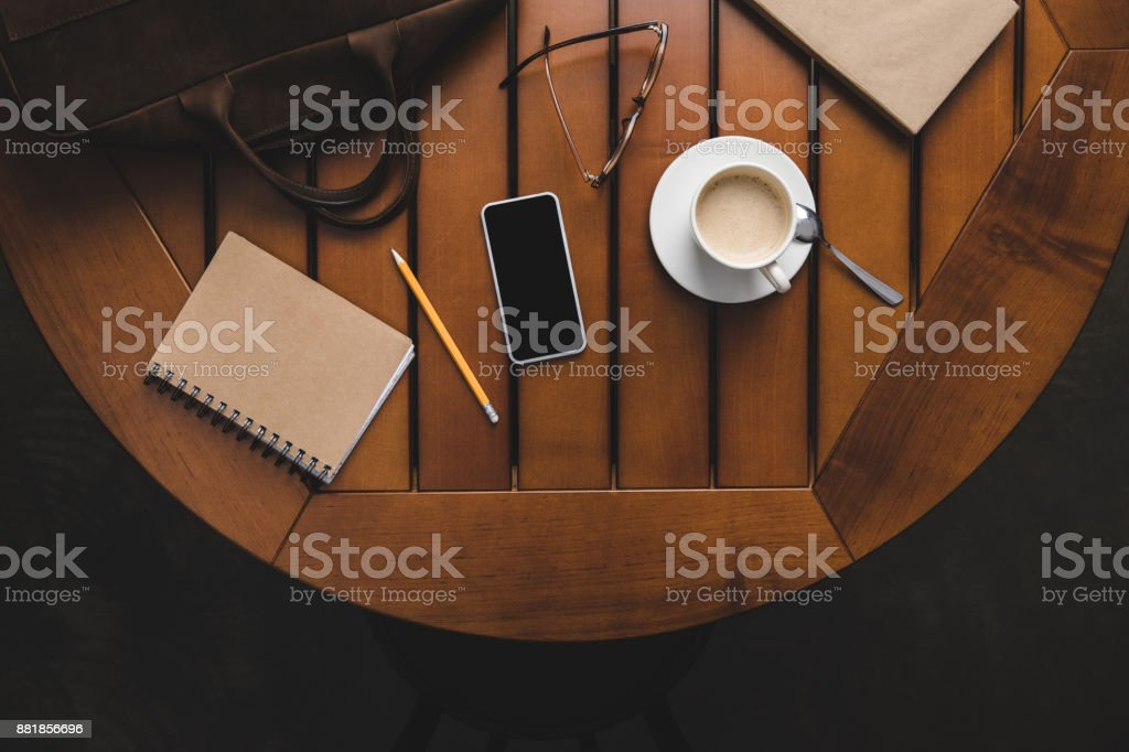 smartphone, notepad and cup of coffee stock photo