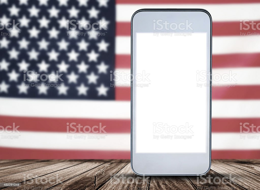 smartphone on a plank wood with us flag stock photo
