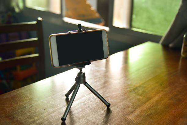 Smartphone on a tripod stock photo