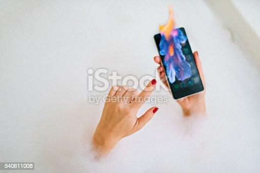 istock Smartphone on fire 540611008