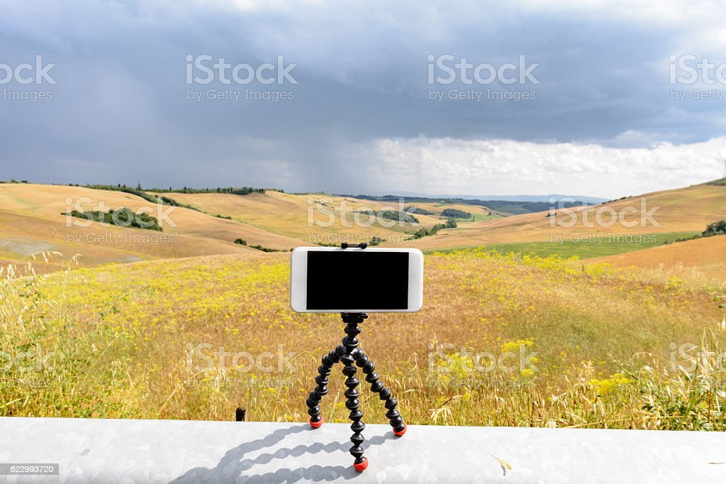 Smartphone on its magnetic tripod stock photo
