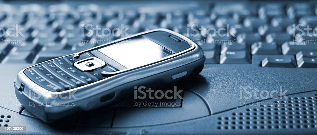 smartphone on laptop royalty-free stock photo