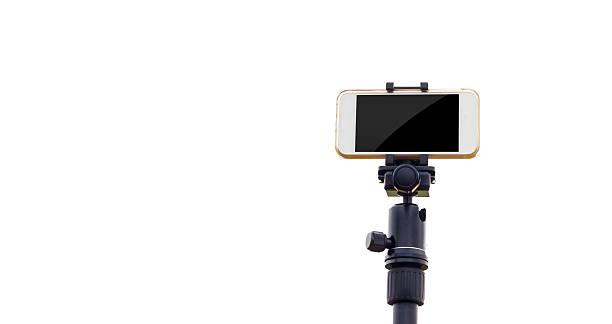 Smartphone on tripod isolate white background stock photo