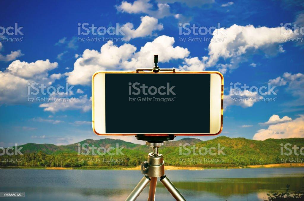 Smartphone on  tripod zbiór zdjęć royalty-free