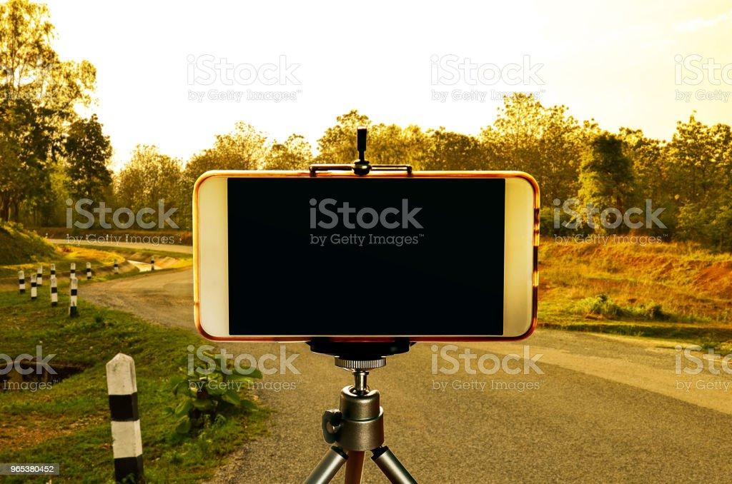 Smartphone on tripod royalty-free stock photo