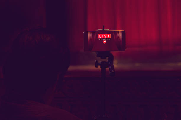 smartphone on tripod wait for video live streaming in theater, technology social concept stock photo