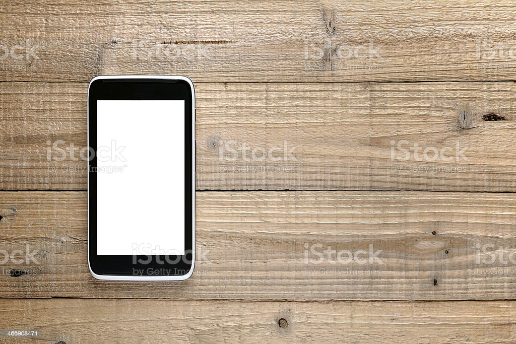 Smartphone on wood stock photo