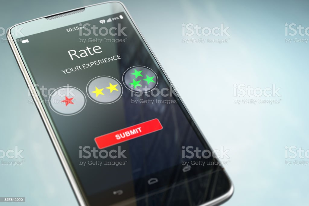 Smartphone or mobile phone with text rate your experience on the screen.  Online feedback rating and review concept. stock photo