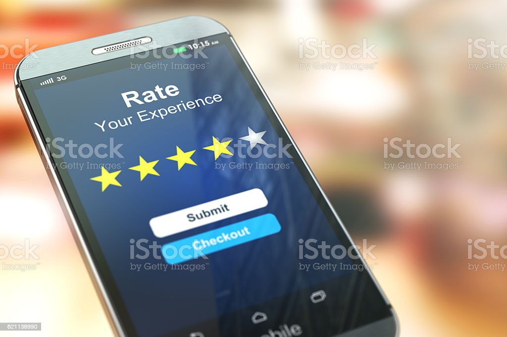 Smartphone or mobile phone with text rate your experience stock photo