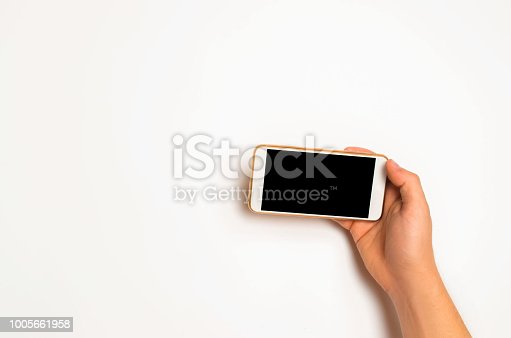istock smartphone, phone in male hands on a white background. the concept of communication. use of gadgets, modern technologies. social networks. place for text. copyspace 1005661958