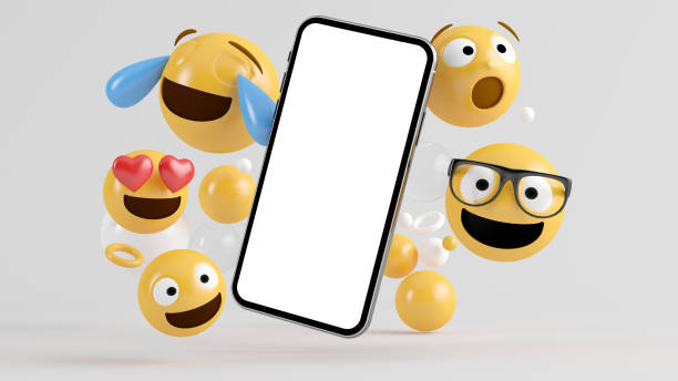 Smartphone screen surrounded by emoji icons stock photo