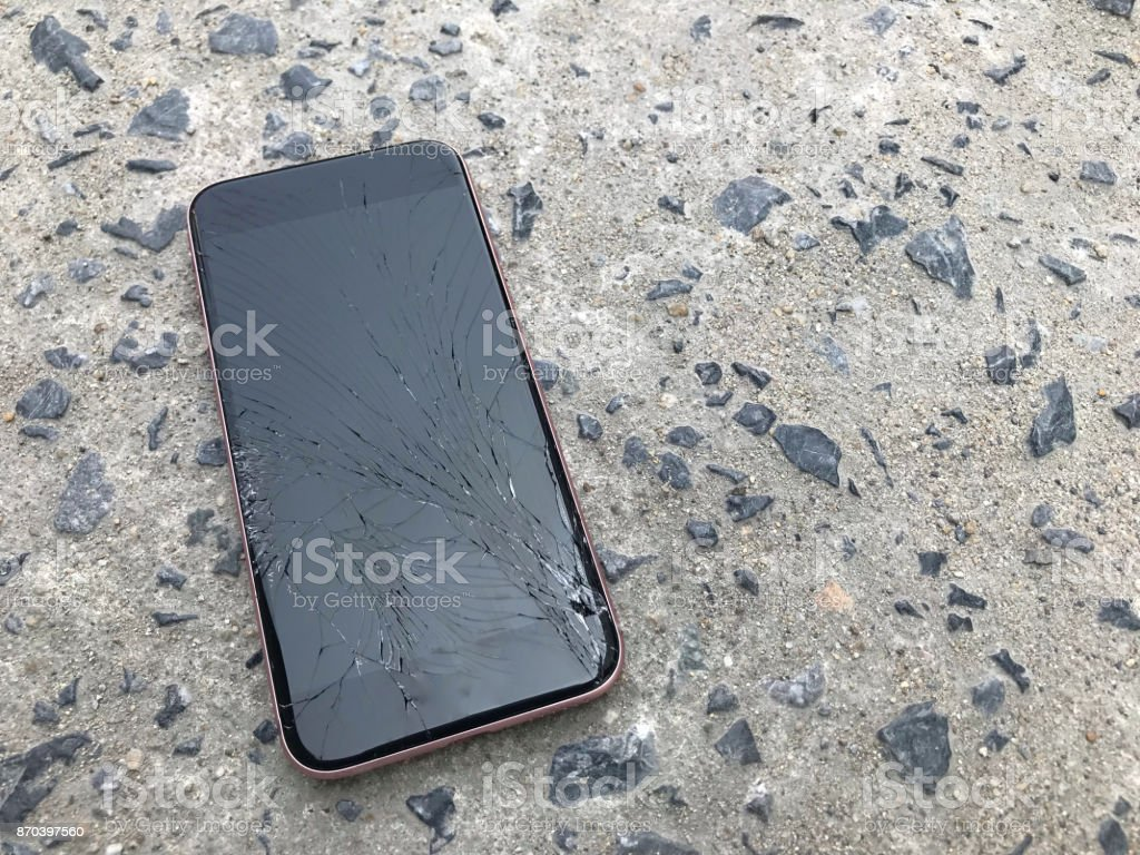 Smartphone screens break from falling ground and space agreement stock photo