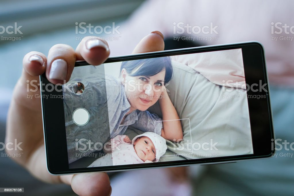 smartphone selfie family newborn mother stock photo