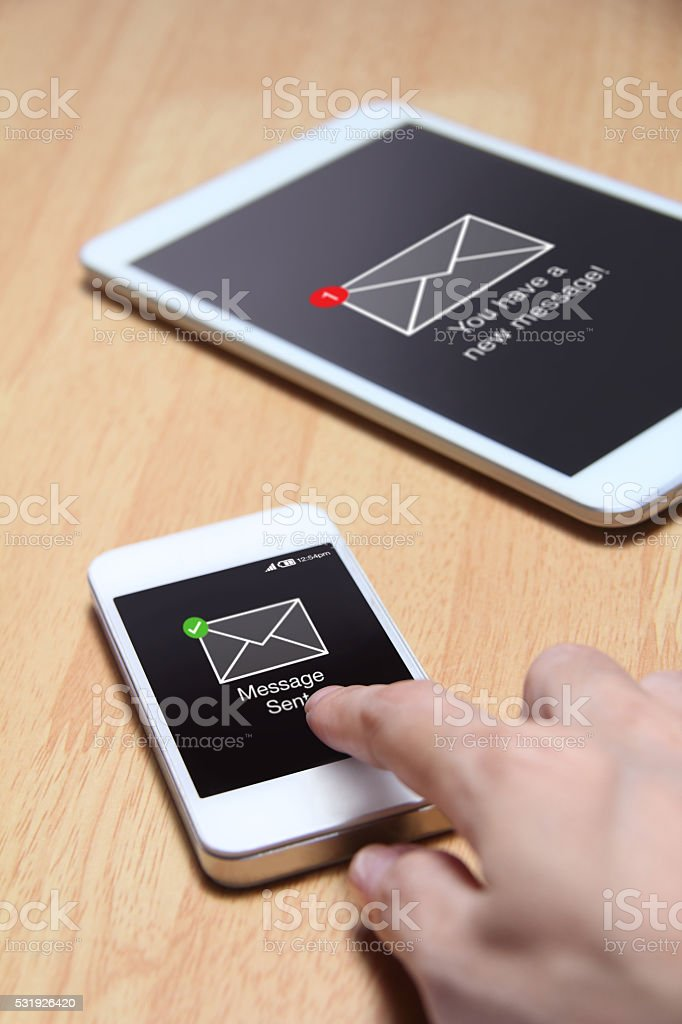 Smartphone send message to other device. stock photo