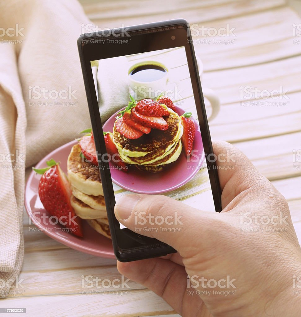 smartphone shot food photo  - pancakes with fresh strawberries stock photo